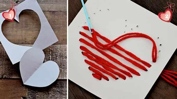 Вышитое сердце на листе картона.