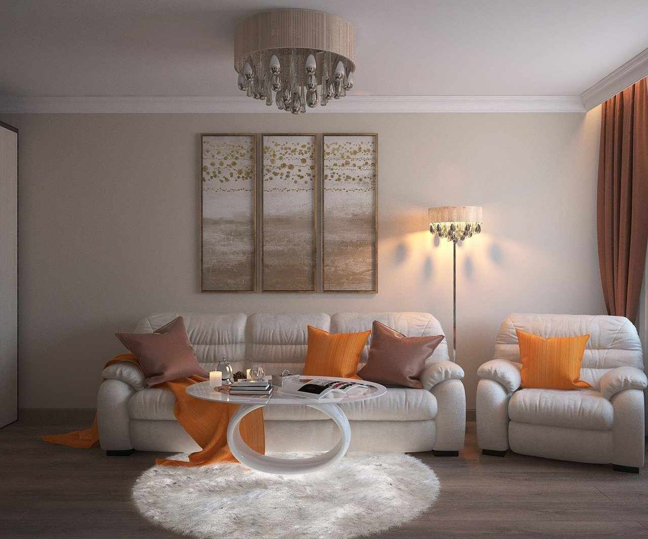 Оранжевые подушки на белой мягкой мебели