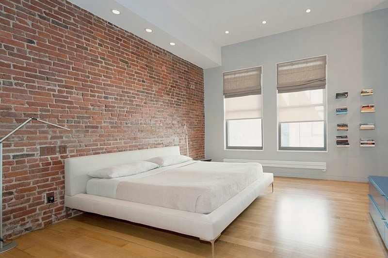 Интерьер в стиле минимализм с кирпичной стеной