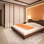 Бело-оранжевый интерьер спальни