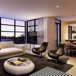 Белый диван и черные кресла в гостиной