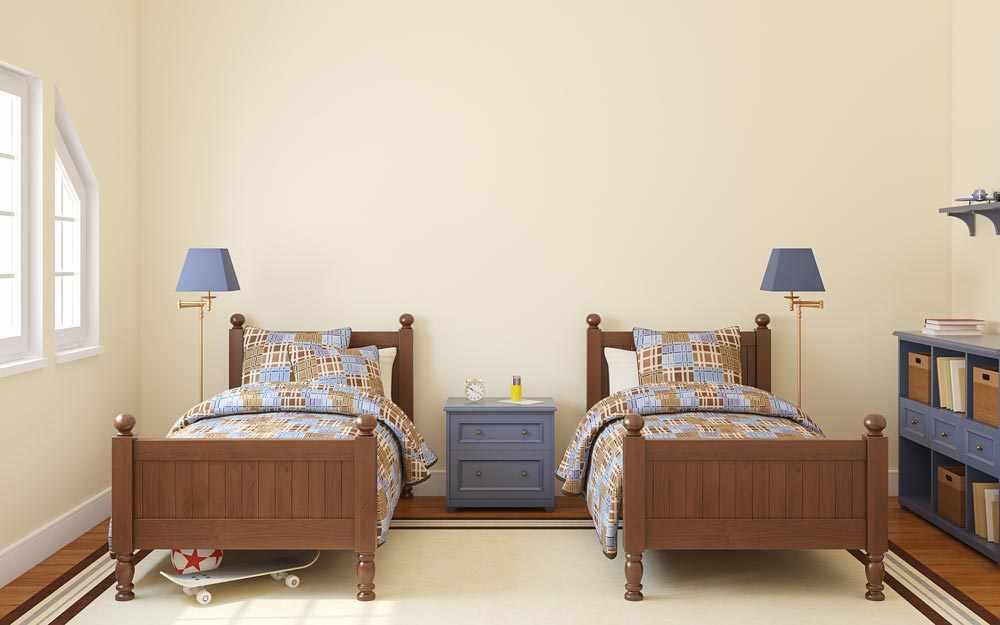 Кровати с одинаковым дизайном в детской для двух мальчиков