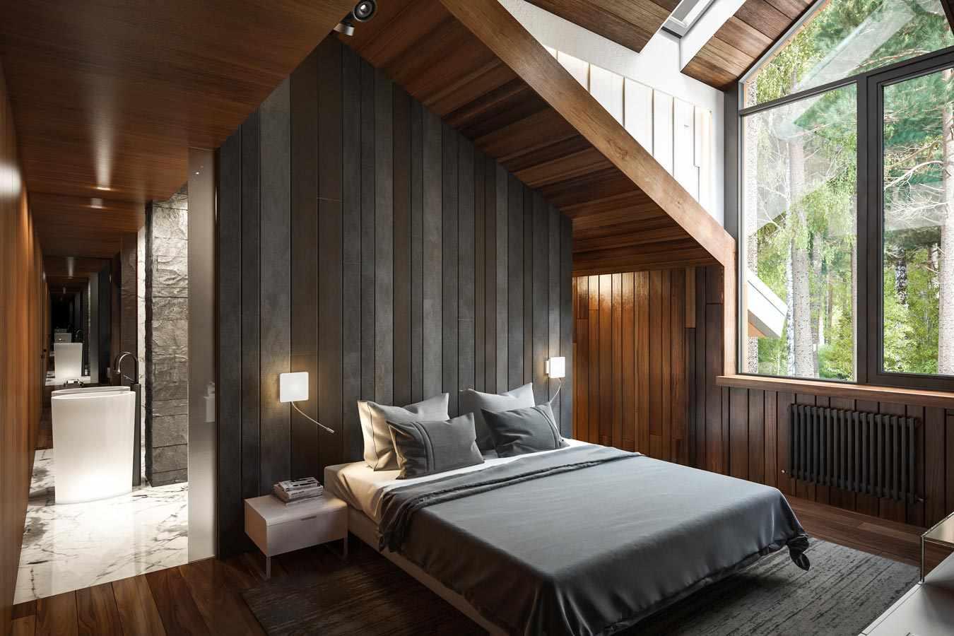 Мансарда с серой кроватью