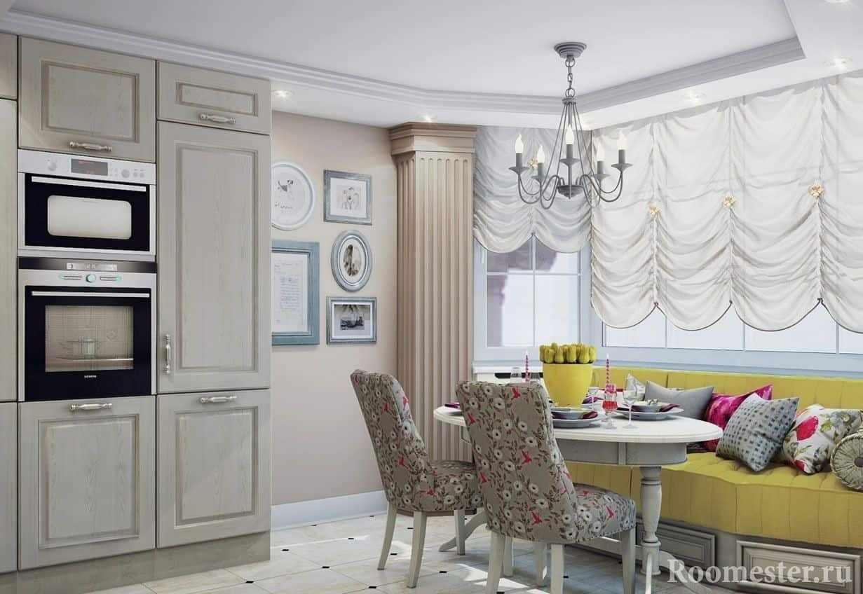 Расположение обеденного стола и мягкого дива на кухне с эркером