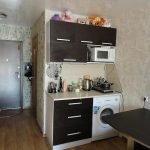 Шкафчики со встроенной микроволновкой на стене