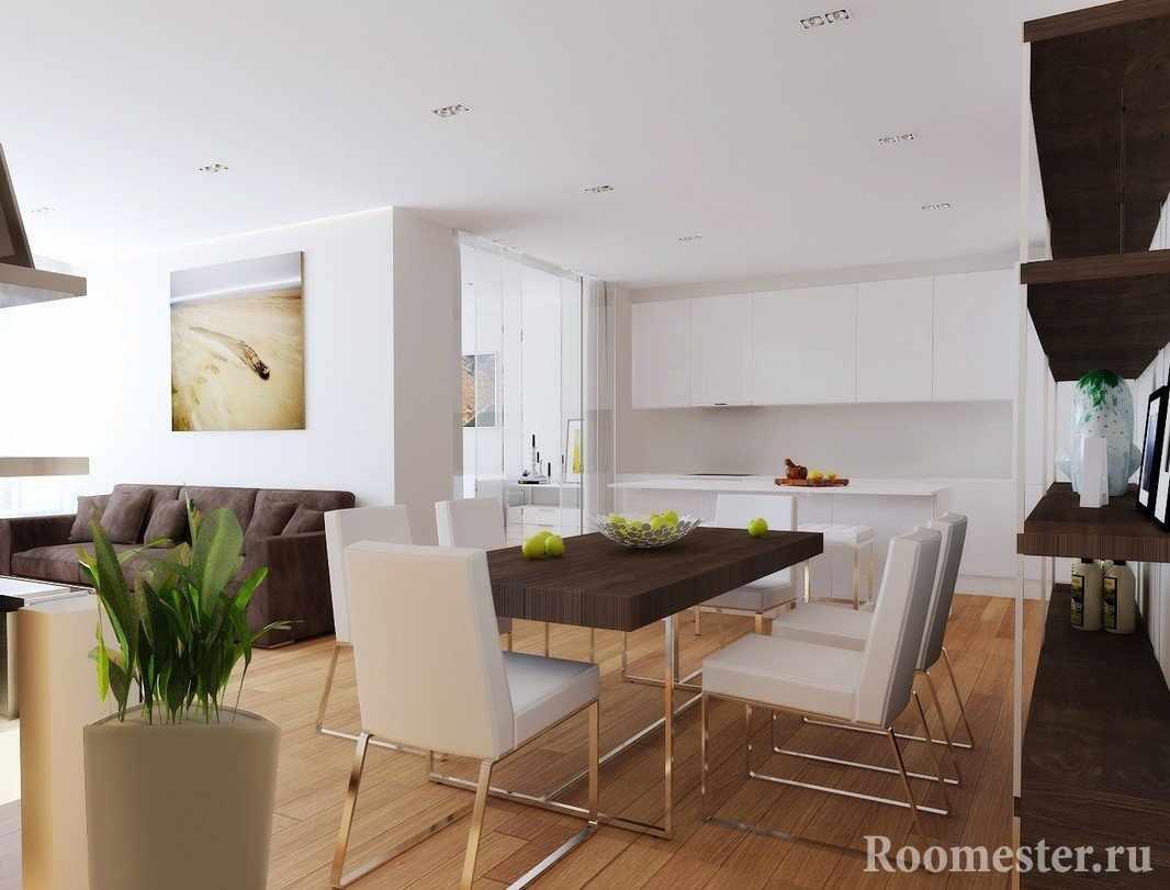 Белая кухня и гостиная со столовой