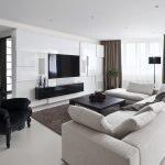 Черные элементы декора в гостиной белого цвета