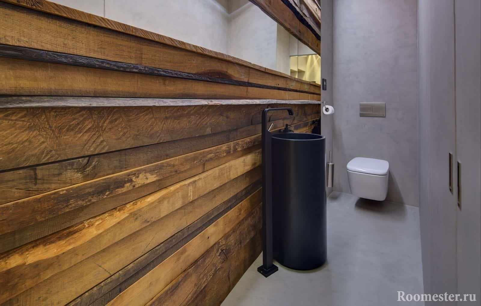 Современный дизайн маленького туалета в эко стиле с необычной раковиной
