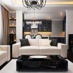 Белые диваны и черное кресло в гостиной