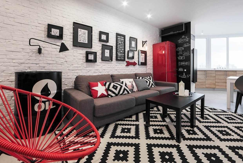 Красные элементы декора в черно-белой квартире студии
