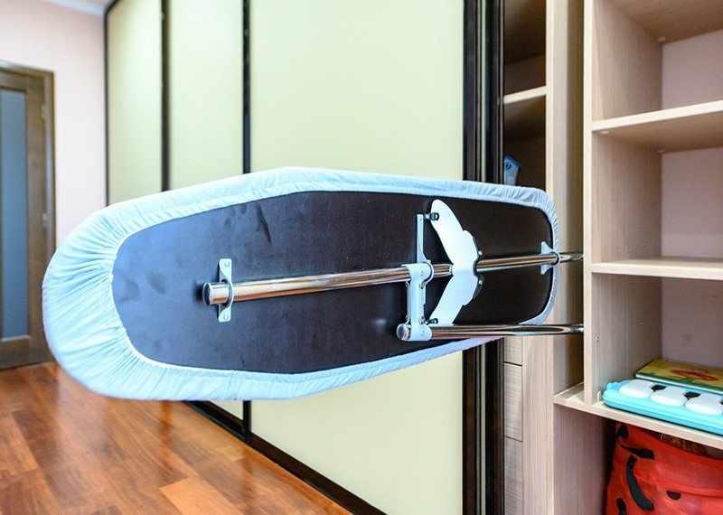 Гладильная доска из ДСП в шкафу