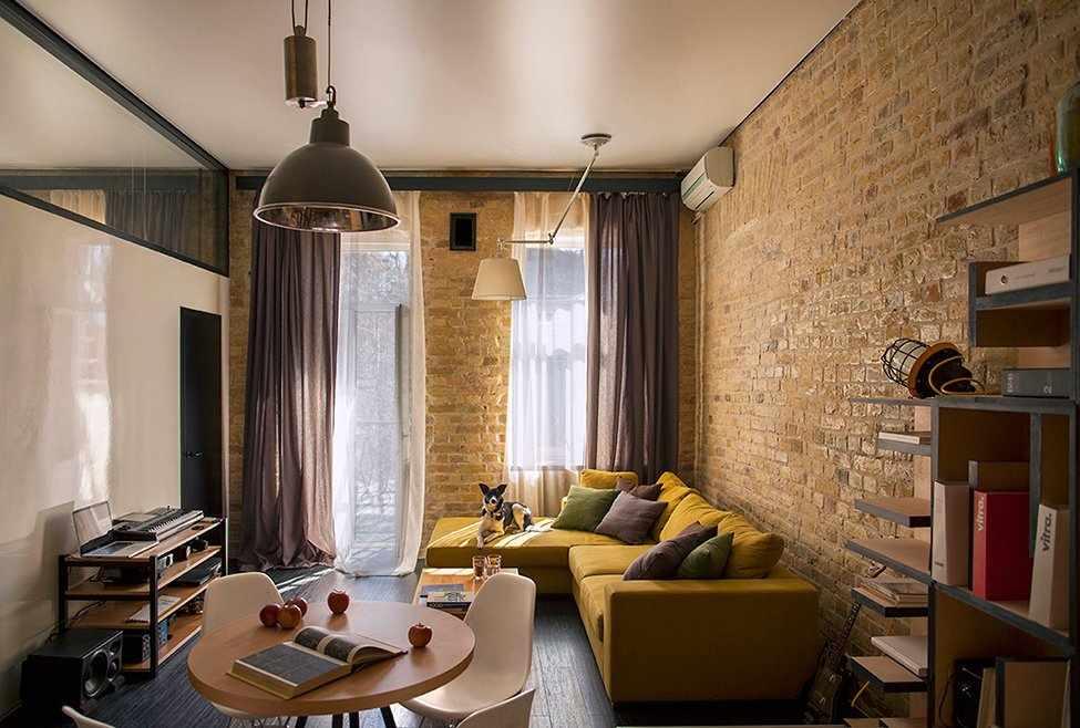 Кирпичные стены в гостиной в стиле лофт