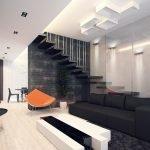 Черный диван и белый столик в интерьере