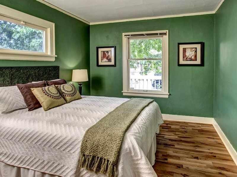 Стильная спальня в зеленых тонах