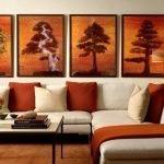 Картины с деревьями над диваном
