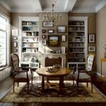 Книжные шкафы по бокам камина