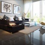 Коричневый диван на глянцевом полу