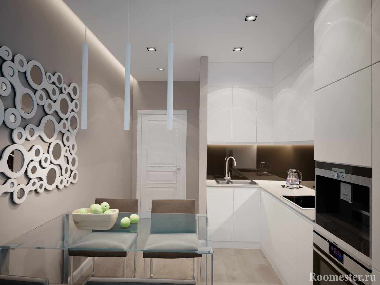 Кухня белого цвета в современном стиле со встраиваемой техникой