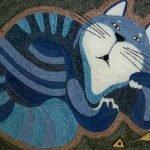 Кот и скелет от рыбы
