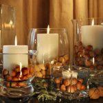 Свечи в вазах с орехами