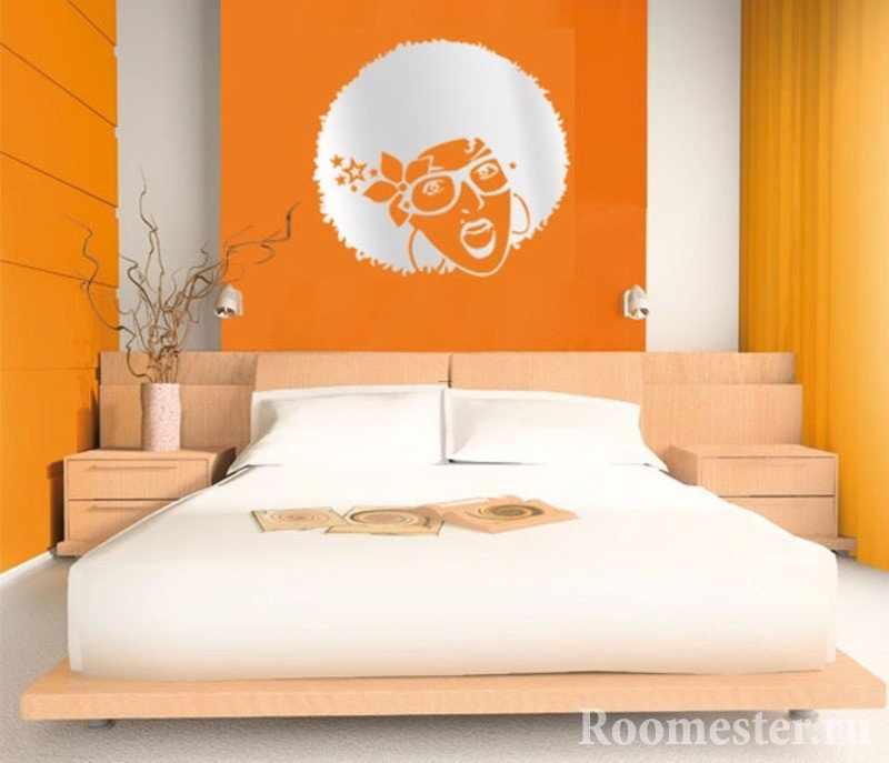 Картина из стикера на оранжевой стене