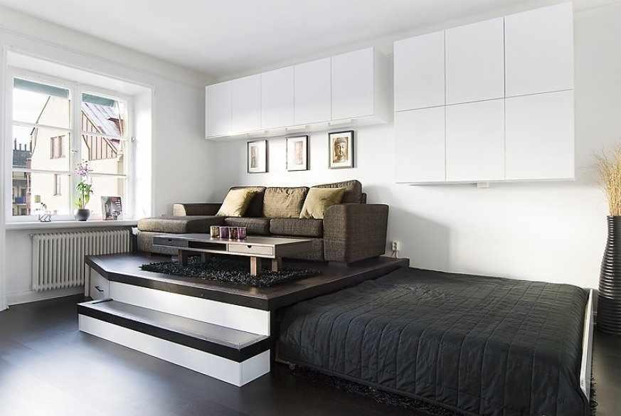 Подиум в интерьере квартиры студии