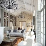 Столик, белые кресла и диван с белыми и серыми подушками