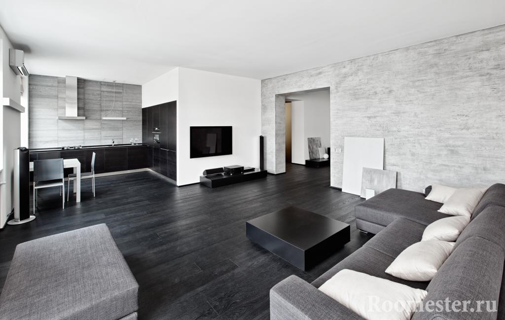Темный пол в интерьере квартиры-студии