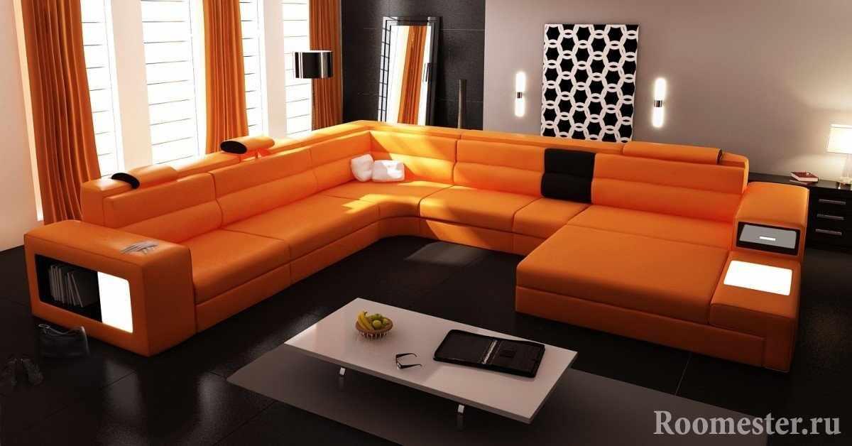 Оранжевый диван в строгой гостиной